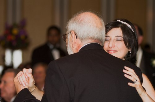 Sima dances with her father, Manny