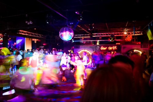 Dancing on Wheels beneath a Mirror Ball at the Down & Derby Roller Disco
