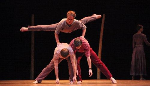 Houston Ballet's program: Of An Era Ballet: Jardi Tancat choreographed by Nacho Duato Dancers: Oliver Halkowich (top) cart wheeling over Ian Casady & Connor Walsh