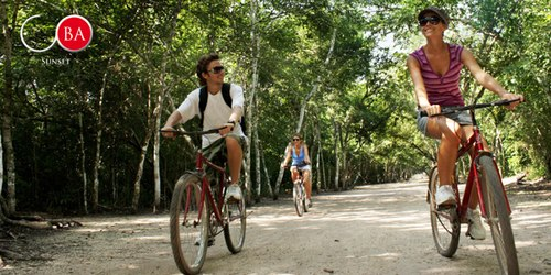 A cool bike ride is refreshing during the Coba Sunset tour