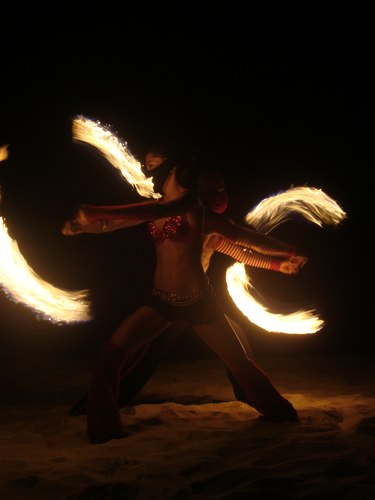 Fuego Rojo dancers entertain people nightly on the beach