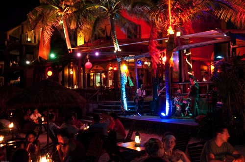 Glowing neon and a lively salsa band at the beachfront Fusion. Note tables on the beach.